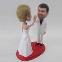 customized bobbleheads of wedding cake topper