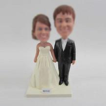 customized bobble head of wedding cake
