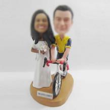 Bobbleheads custom bike wedding cake