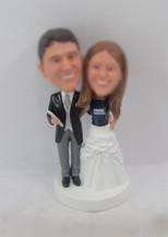 happiness wedding cake bobblehead dolls