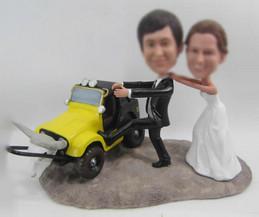 Personalized custom wedding cake with car bobbleheads