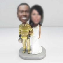Personalized custom Fireman wedding cake bobbleheads