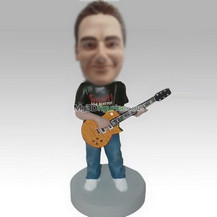 Personalized bobbleheads man and guitar