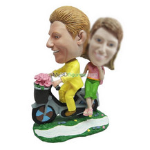 Personalized couple in red car bobbleheads
