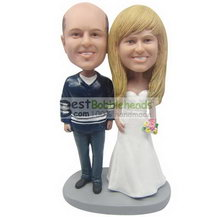 groom in navy uniform and bride in white wedding dress bobbleheads
