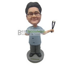 male doctor holding up with a operating forceps bobbleheads