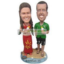 wife in red dress and husband in green T-shirt bobbleheads