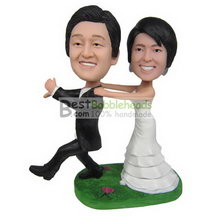 funny groom in black suit and funny bride in white wedding dress bobbleheads