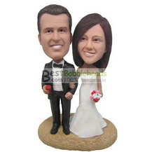 groom in black suit and bride in white wedding dress bobbleheads