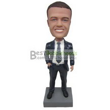 cool man in black suit matching with a gross grain tie bobbleheads