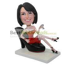 custom hot girl sitting on a big high-heeled shoe bobbleheads